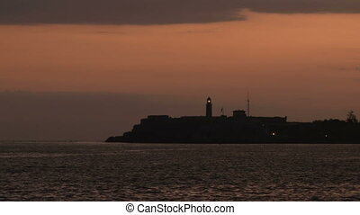 Shinning morro 2 - Siluette of Morro castle lighthouse