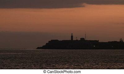 Shinning morro 2 - Siluette of Morro castle lighthouse
