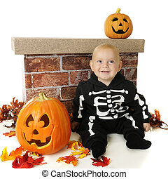 Happy Little Skeleton - An adorable baby happily sitting...