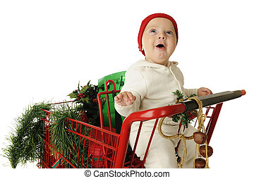 Awed by Christmas - An adorable baby boy delightedly looking...