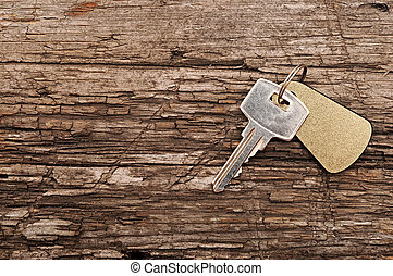 single key on a wooden table
