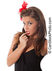 Sexy pin-up teenage girl with red feather in her hair