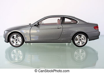 Lateral scene with miniature model of a car over glass...