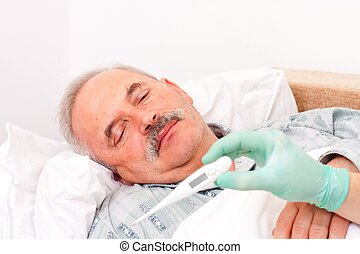 Senior man with fever - Elderly man laying in bed, nurse...