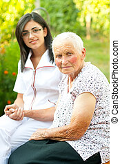 Homecare - A young doctor / nurse visiting an elderly sick...
