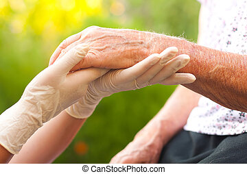 Elderly hand - Doctor examining elderly woman's hand at...