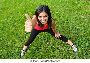 Thumbs up - Healthy lifestyle - Beautiful young girl...