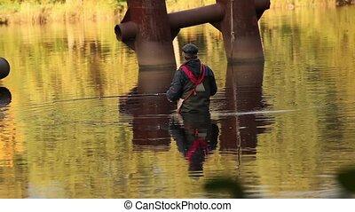 fisherman in golden water