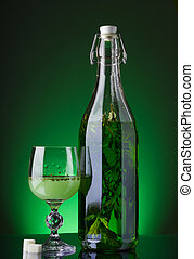 Absinthe glass and bottle with lump sugar