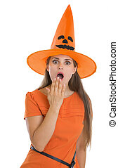 Surprised young woman in Halloween hat
