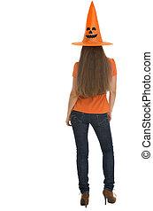Woman in Halloween hat. Rear view