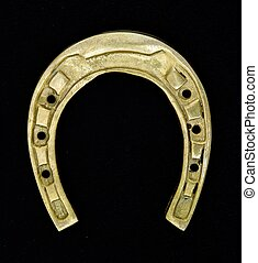Horseshoe - Amulet. Horseshoe on a black background