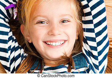 face smiling girl - cute smiling girl looking at the camera