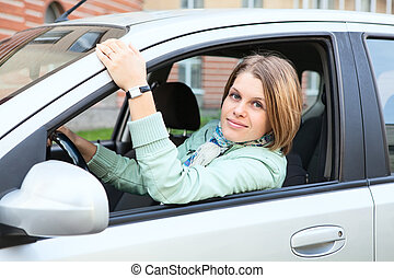 Woman with blond hair in land vehicle