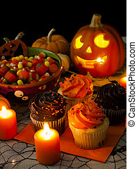 Halloween Cupcakes - Halloween cupcakes with orange and...