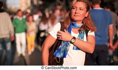 walking slow motion - woman walking on the very crowded...