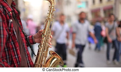 saxophone - man play saxophone on the street