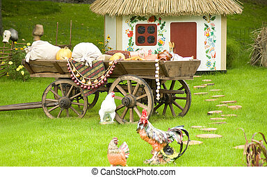 Beautiful rural cottage and vehicles or wagons in summer...