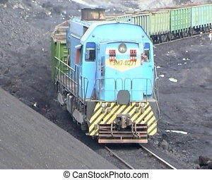 Coal mining. - Coal wagons on railway tracks. The Empty...