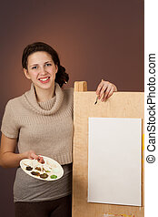 Teenager girl painting a picture