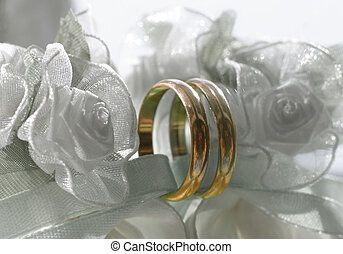 Wedding rings on a satiny tape Selective color wedding rings...