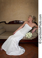 Bride Sofa - A bride sitting in a couch in her dress