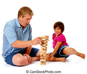 Ready to Topple - A dad playing a block balancing game with...
