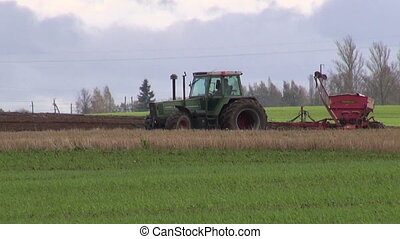 tractor with sowing machine on autumn field