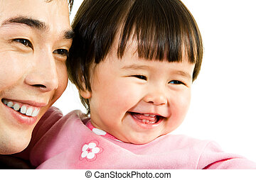 Joy - Close-up of happy father with daughter looking aside...