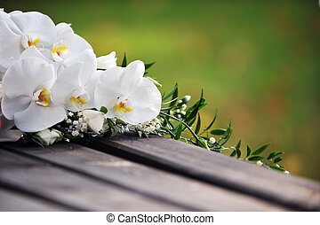 white orchid - Wedding bouquet from white orchid on wooden...
