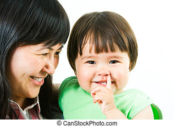 Cutie - Image of happy mother looking at her cute little...