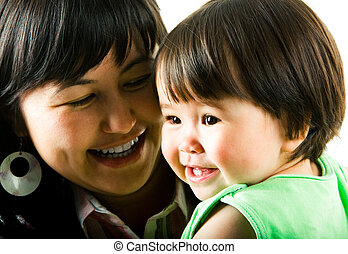 Mother with baby - Face of smiling little girl with her...