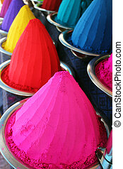 Piles and mounds of colorful dye powders for holi festival &...