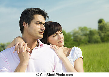 meadow - Couple standing in meadow, arm around and looking...