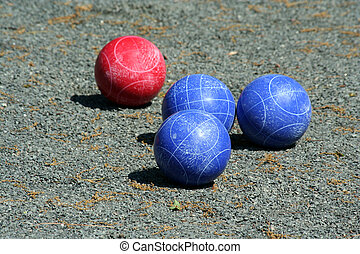 Bunch of bocce balls on a court
