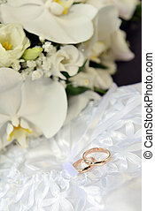 orchids and wedding rings - white orchids and wedding rings...