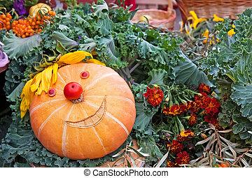 Smiling pumpkin on a harvest festival