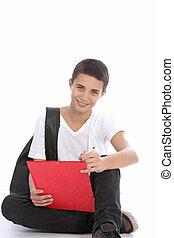Cheerful teenage boy writing notes - Cheerful teenage boy...