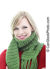Smiling young woman in a winter scarf
