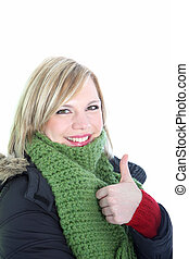 Woman in winter attire giving thumbs up