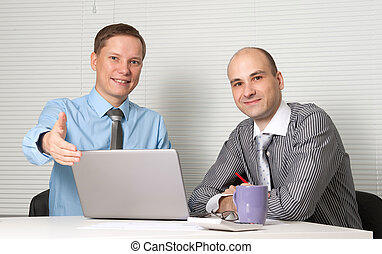 Two businessmen in office