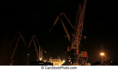 Loading cargo - Cranes loading cargo at night