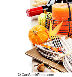 Thanksgiving table setting with pumpkins and candle isolated...
