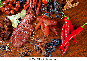 meat and sausages - different sausage and meat on a...