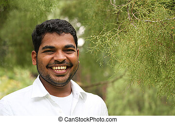 Close-up image of happy, excited & handsome asian/indian...