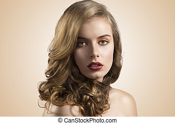 portrait of girl with wavy hair in front of the camera
