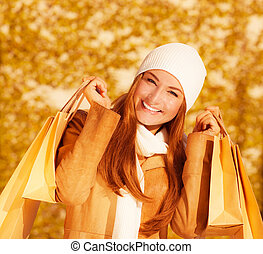 Cheerful woman with paper bags - Image of attractive...