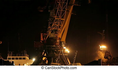 Cargo industry - A crane loading cargo at night
