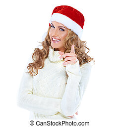 Young woman with a Santa hat pointing