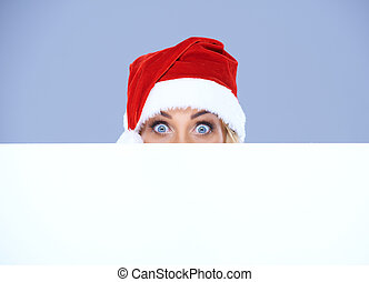 Woman head and eyes with Santa hat above white board - Woman...